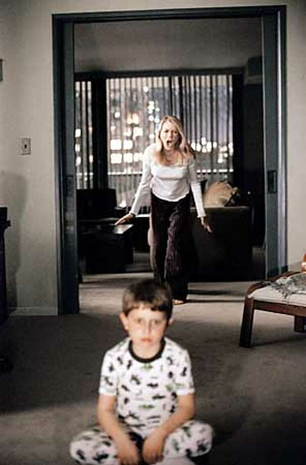 To her horror, Rachel Keller (NAOMI WATTS) finds she is too late to stop her son Aidan (DAVID DORFMAN) from watching a videotape that dooms anyone who sees it to death in seven days in DreamWorks Pictures� suspense thriller THE RING. Photo: Merrick Morton Photo: HANDOUT