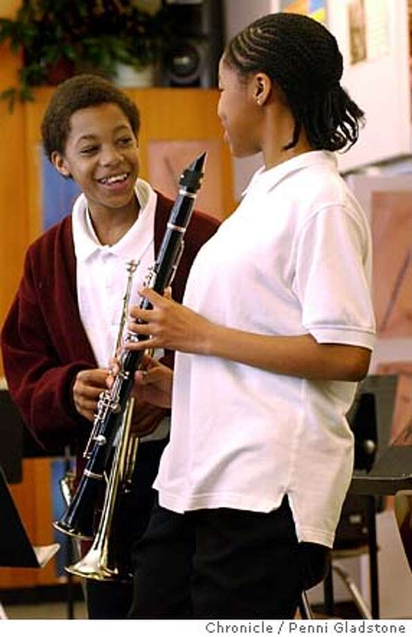 Practicing, Javier Francis shares a laugh with Mikala King-Anderson, both age 12. Javier plays the trumpet and Mikala plays the clarinet.  AT THE GLORIA R. DAVIS MIDDLE SCHOOL IN HUNTERS POINT there is a Shortage of instruments so many were donated. These are kids benefiting from them and the strong music program.  Photo taken on 03/04/04 in San Francisco, CA.  Photo By PENNI GLADSTONE / The San Francisco Chronicle Photo: PENNI GLADSTONE