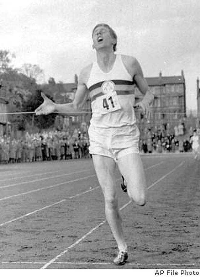 ** ADVANCE FOR WEEKEND EDITIONS, MAY 1-2 -- FILE -- ** Britain's Roger Bannister crosses the finish line, running a mile in 3:59.4 in Oxford, England, in this May 6, 1954 photo. Half a century later, that magic time still stands out as one of the defining sports moments of the 20th century. (AP Photo/File) MAY 2, 1954 PHOTO