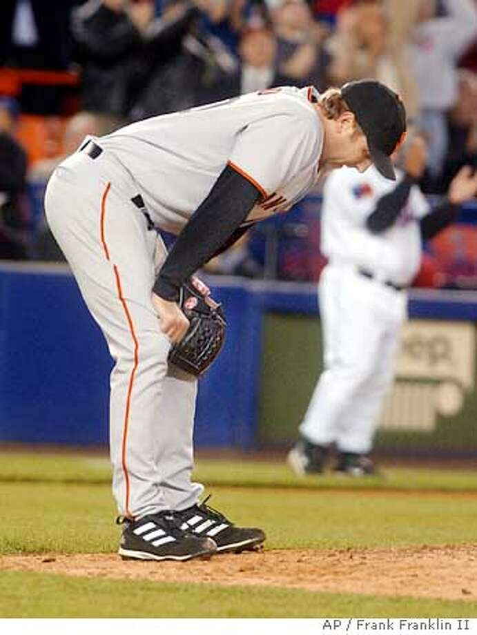 San Francisco Giants Brett Tomko reacts after New York Mets Mike Cameron hit a two-run home run in the the sixth inning at New York's Shea Stadium Tuesday, May 4, 2004. (AP Photo/Frank Franklin II) Photo: FRANK FRANKLIN II
