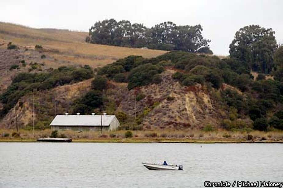 MILPARK17b-C-15OCT02-OT-MJM  A fisherman motors past the south end of Mare Island, military land which is reverting to public use eithe ras wildlife habitat, and/or recreation sites. CHRONICLE PHOTO BY MICHAEL MALONEY