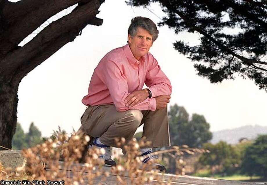 ROWELL INT/C/06AUG97/OT/CS - Photographer Galen Rowell is releasing his new photo book on Bay Area wildlands. The book includes several photos taken at Berkeley Aquatic Park, where he crouches on a dock. SAN FRANCISCO CHRONICLE PHOTO BY CHRIS STEWART