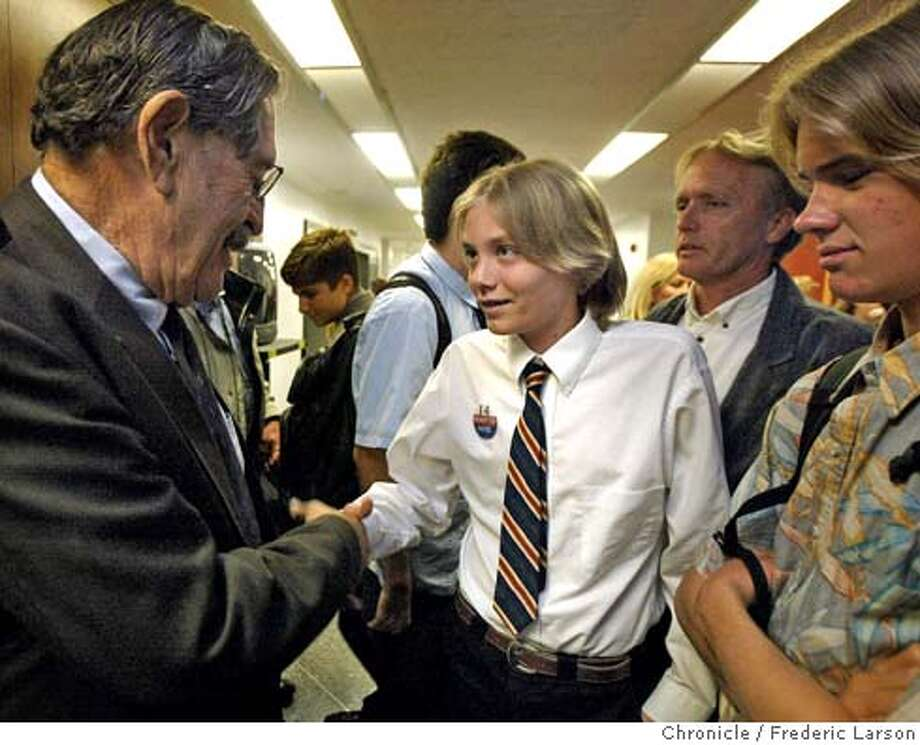 ; Ian Magruder (14) of Santa Cruz meets State Sen. John Vasconcellos who introduced a bill that would allow 14-year-olds to vote. Several teenagers, including, Ian (center), Devin Murphy (13) (right) and Ian father Clark Magruder and a member of the youth commission from San Francisco testify at the State Capital building in Sacramento. 5/5/04  San Francisco Chronicle Frederic Larson Photo: Frederic Larson