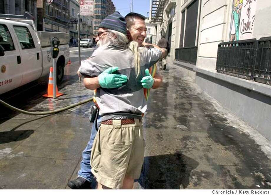 SHOWN: After his DPW crew cleaned the sidewalk on Jones St. just south of Golden Gate Ave., Cesar Luna (wearing green gloves) gets a hug from former DPW worker Frankie Rivera, who lives just up the street on McAllister. Massive cleanup in the Tenderloin by DPW, PUC, and DPT. Katy Raddatz / The Chronicle Photo: Katy Raddatz