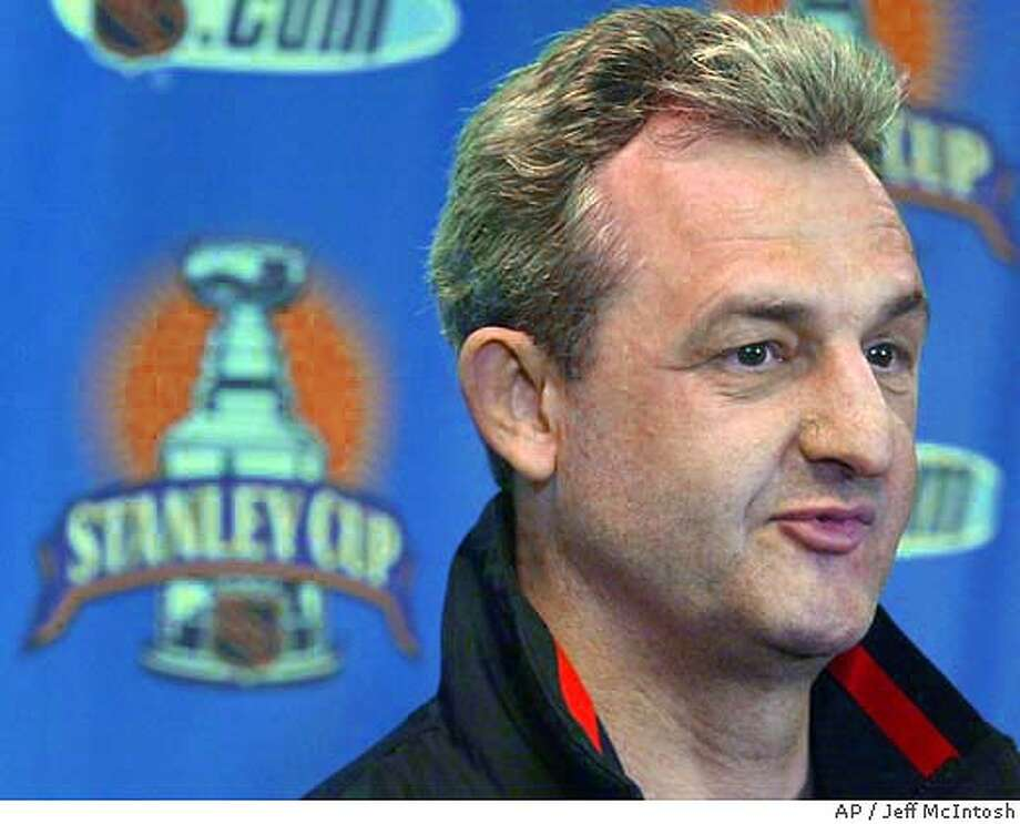 Calgary Flames general manager and head coach Darryl Sutter speaks to the media in Calgary, Wednesday, May 5, 2004. The Flames will face the San Jose Sharks in the NHL Western Conference final. The first game is Sunday, May 9. (AP Photo/Jeff McIntosh) Photo: JEFF MCINTOSH