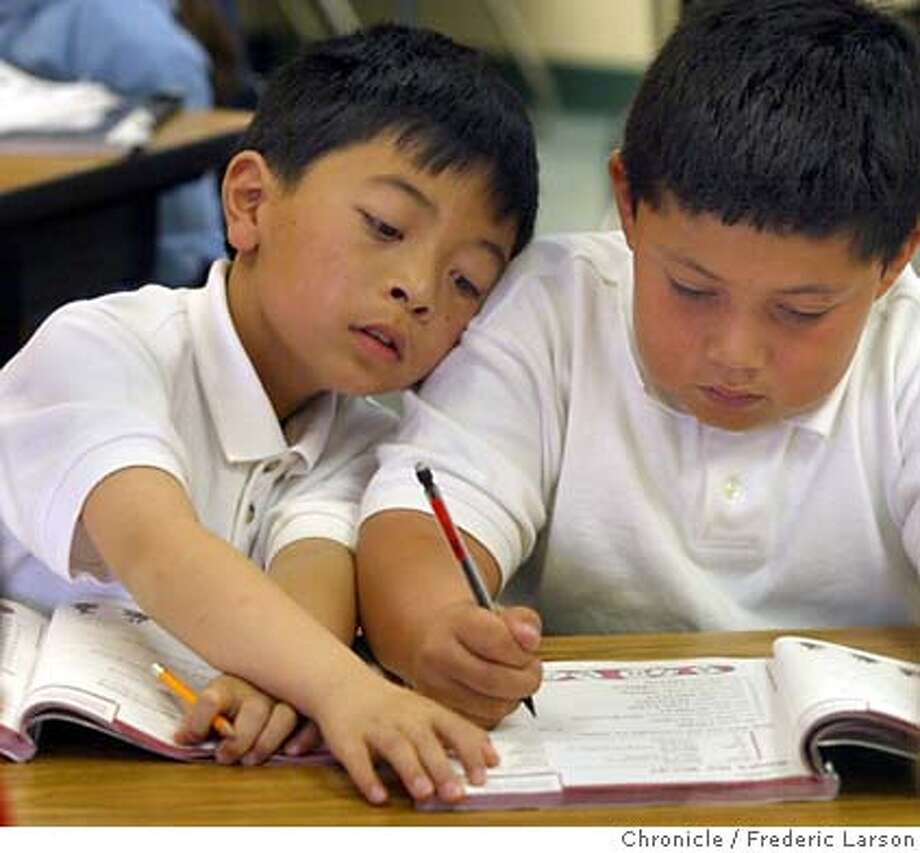 """; David Liu (9) right and Cristian Canado help team up to solve a problem during Angie Estonina 3rd grade class at Moscone Elementary in SF. � Moscone Elementary is a a high poverty, mostly Latino school in the Mission District, scored the coveted """"10"""" in the API category measuring schools against ones with similar demographics. With an 802 API score, the school is considered excellent by state standards. It�s so good, the local chapter of the United Way highlighted it in a new report called """"Getting the Grade"""" about testing in the Bay Area. City:� 3/9/04, in San Francisco, CA. Frederic Larson/The Chronicle; Photo: Frederic Larson"""