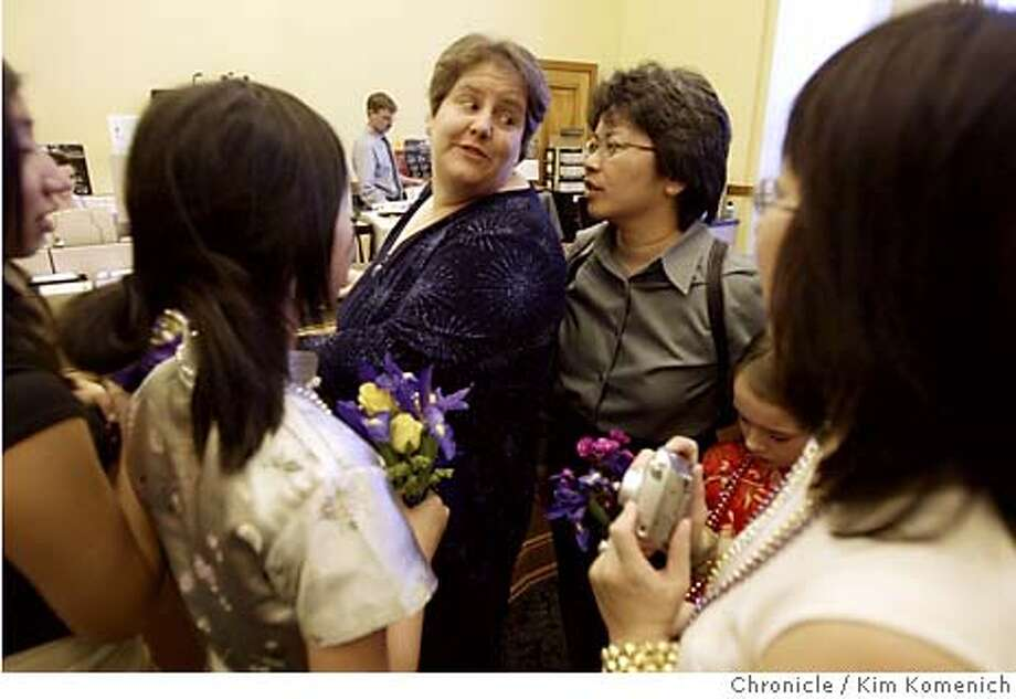 Same-sex marriage.  Jan Bunten (L) and Ellen Cheung (R) of Concord get married at San Francisco City Hall with lots of family in attendance. Here they apply for the marriage license in the County Clerk's office. Chronicle photo by Kim Komenich in San Francisco Photo: Kim Komenich