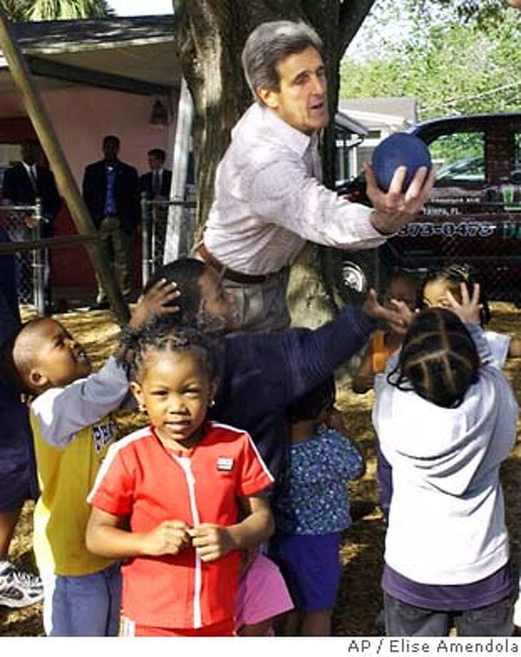 Democratic presidential hopeful Sen. John Kerry, D-Mass., plays ball with children during a campaign stop at Little Big World Day Care Center in West Tampa, Fla. Tuesday, March 9, 2004. (AP Photo/Elise Amendola) Sen. John Kerry plays ball with children during a campaign stop at Little Big World Day Care Center in West Tampa, Fla. Photo: ELISE AMENDOLA