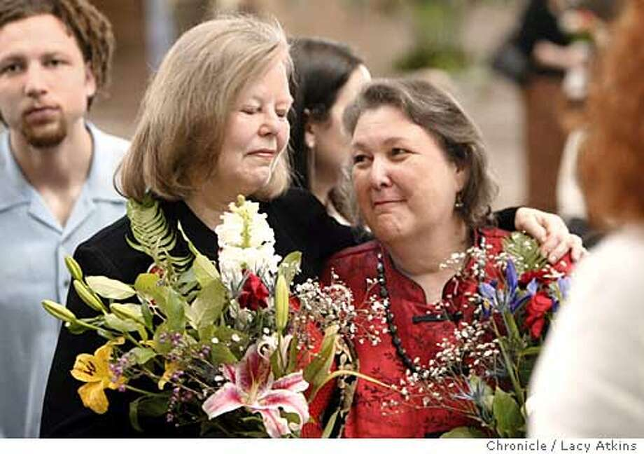 Sharon Stricker and partenr Jackie Goldberg share a moment at their wedding with their sone Brian Goldberg behind them at City HAll in San Francisco, March 8, 2004.  State assemblywoman Jackie Goldberg marries partner of 28 years Sharon Stricker with State Senator Sheila Kuhel performing the ceremony at the San Francisco City Hall.  LACY ATKINS / The Chronicle Photo: LACY ATKINS