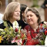 Sharon Stricker and partenr Jackie Goldberg share a moment at their wedding with their sone Brian Goldberg behind them at City HAll in San Francisco, March 8, 2004.  State assemblywoman Jackie Goldberg marries partner of 28 years Sharon Stricker with State Senator Sheila Kuhel performing the ceremony at the San Francisco City Hall.  LACY ATKINS / The Chronicle
