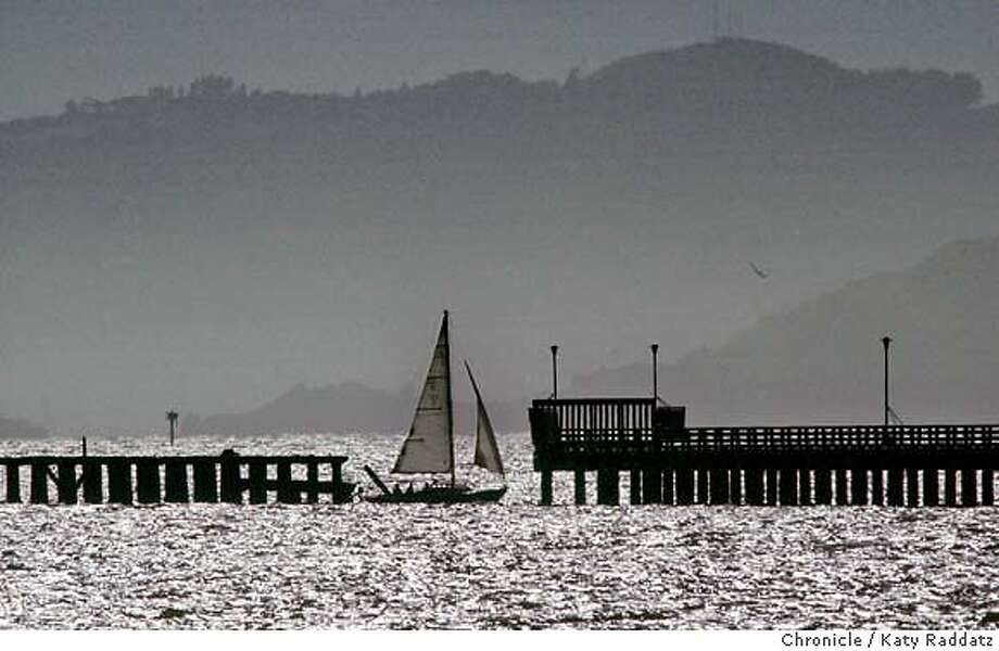 Weather shots from the Berkeley Marina. SHOWN: A sailboat sails through one of the many gaps in the Berkeley Pier. Katy Raddatz / The Chronicle Photo: Katy Raddatz