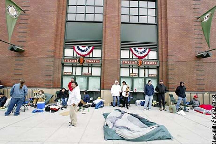 A line of Giants fans trying to get World Series tickets has formed outside Pacific Bell Park...but park officials insist a lottery system will leave few tickets available...but still they wait for tomorrow to see for sure. By Brant Ward/Chronicle Photo: BRANT WARD
