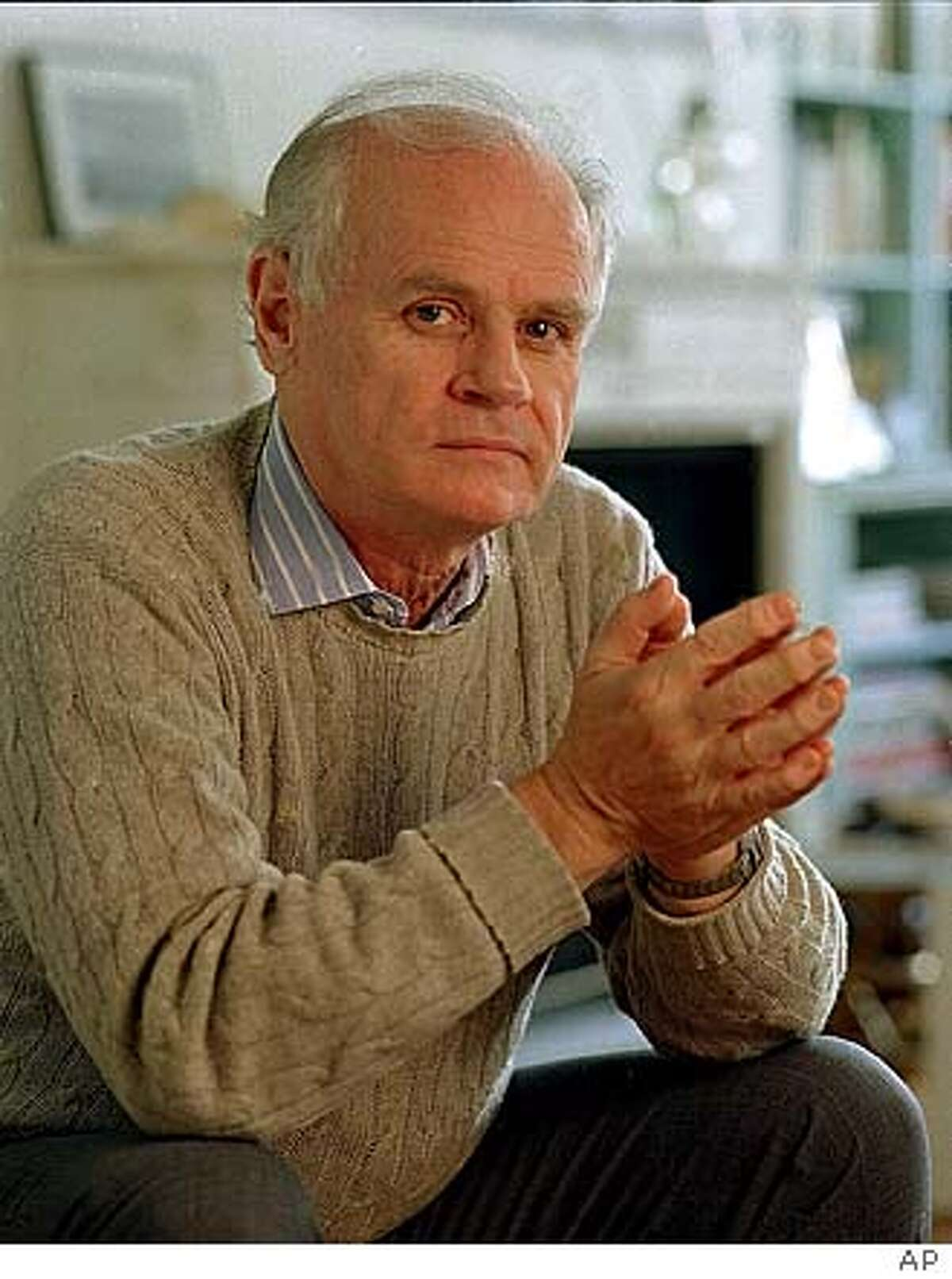 Author John Gregory Dunne, shown in his New York apartment, incorporates into his writing the three