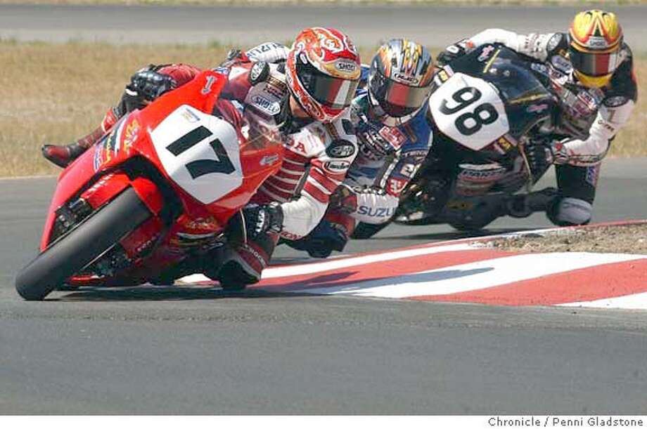 #17 Miguel Duhamel from Repentigny, QC, Canada is the winner of this race. #98 Jake Zemke of Paso Robles, CA. Zemke led most of the race and came in second.  SUPERCUTS SUPERBIKE CHALLENGE, 1000CC motorcycles racing on road courst at In  SUPERCUTS SUPERBIKE CHALLENGE, 1000CC motorcycles racing on road courst at Infineon Raceway.  photo taken on 5/2/04 in Sonoma, CA.  must credit photo by Penni Gladstone/ Photo: Penni Gladstone