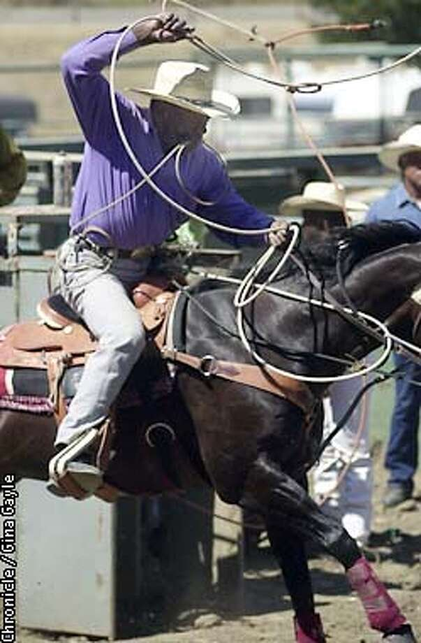 FJ Jones, 60, of California still has what it takes as he breaks out of the chutes in the calf roping event at the recent Bill Pickett Invitational Rodeo at the Rowell Ranch Rodeo Park in Hayward. Photo by Gina Gayle/The SF Chronicle. Photo: GINA GAYLE