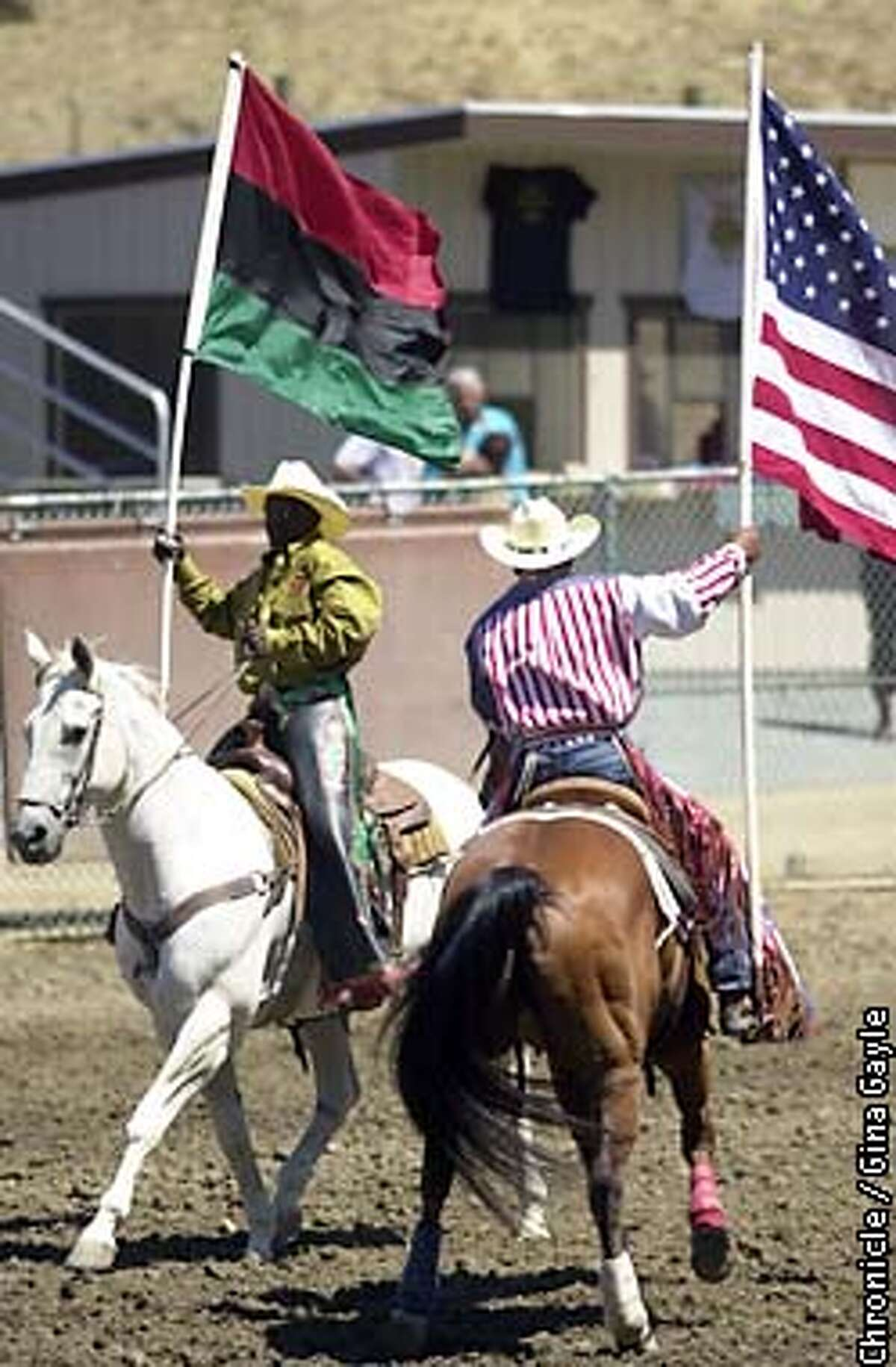 During the Grand Entry of the Bill Pickett Invitational Rodeo, the African flag and the American flag were brought into the stadium. This year the California State Fair has chosen to eliminate the Black rodeo and replace it with a multiculteral rodoe which has caused controversy. Photo by Gina Gayle/The SF Chronicle.