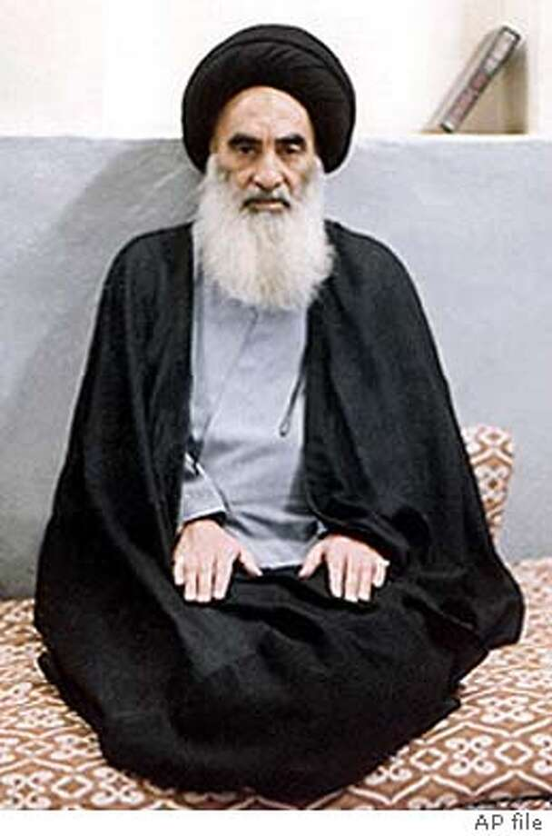 *FILE (NYT66) UNDATED -- February 5, 2004 -- IRAQ-SISTANI -- Unidentified attackers tried unsuccessfully on Thursday, Feb. 5, 2004, to kill Iraq's most powerful spiritual leader, Grand Ayatollah Ali al-Sistani, according to some accounts in Baghdad. An undated file photo of al-Sistani. (The New York Times) Grand Ayatollah Ali al-Sistani is resented by some Shiites. XNYZ, *FILE Paul Bremer Paul Bremer Governing Council member Younadem Kana raises the newly signed interim constitution during the Baghdad signing ceremony. Photo: ...