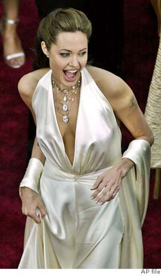 Actress Angelina Jolie arrives at the Sunday, Feb. 29, 2004, in the Hollywood section of Los Angeles. This is the 76th annual Academy Awards. (AP Photo/Ric Francis) Photo: RIC FRANCIS