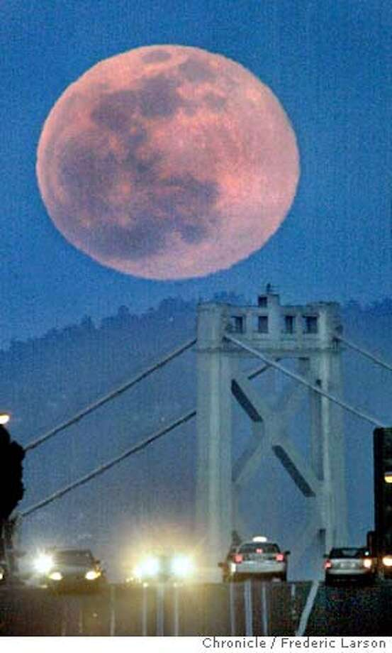 ; The moon showed herself over the east bay hills looking down California Street at the top of Nob Hill in San Francisco SF., as clear skies and spring temperatures made records over the week-end. City:� 3/6/04, in San Francisco, CA. Frederic Larson/The Chronicle; Photo: Frederic Larson