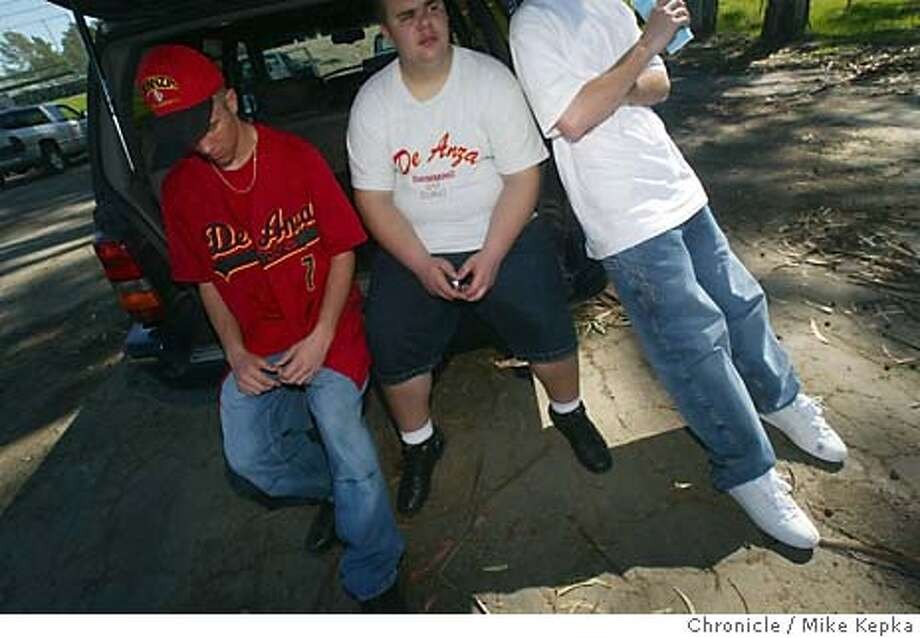 After most left the classrooms with the word that West Contra Costa County Schools were cutting their sports programs next year, DeAnza High baseball player Billie Davis, 16, waits behind the school with his friends Tommy Ryan, 16, swimmer and football player and baseball player Chad Masters, 16, for an afternoon baseball game. Davis says he will try to transfew to anotyher school if their is no baseball next year. Davis can be reached at 510 685-9178 and Ryan can be reached at 510 334-4256.  Mike Kepka / The Chronicle Photo: Mike Kepka