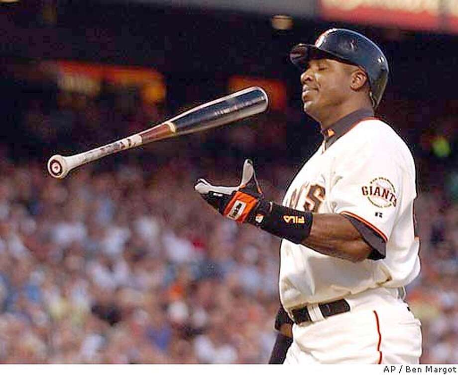 San Francisco Giants' Barry Bonds flips his bat after striking out against Atlanta Braves' Horacio Ramirez in the second inning Monday, April 26, 2004, in San Francisco. (AP Photo/Ben Margot) Photo: BEN MARGOT
