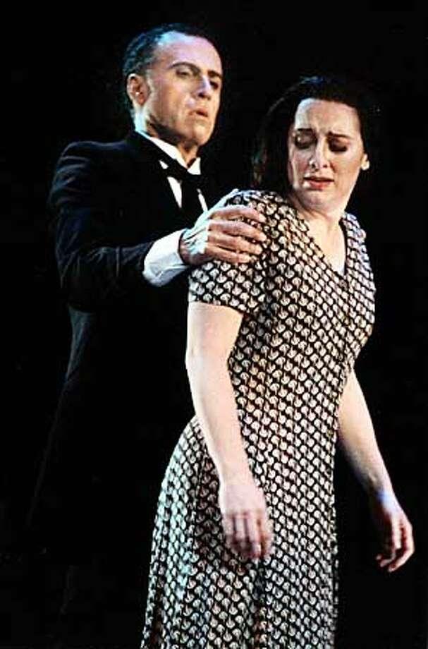 SUSANNAH12B-C-09AUG02-DD-HO --- Cynthia Clayton as Susannah with Hector Vasquez as Rev. Olin Blitch in Festival Opera's production of Carlisle Floyd's Susannah  (HANDOUT PHOTO)