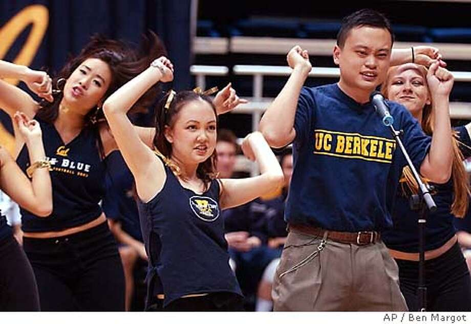 """William Hung, right, performs the Ricky Martin song """"She Bangs"""" during halftime of the University of California's men's volleyball game Wednesday, Feb. 18, 2004, at Haas Pavilion in Berkeley, Calif. The """"American Idol"""" judges said Hung bombed with his gotta-see-it-to-believe-it rendition of """"She Bangs."""" But rejection turned out to have a silver -- maybe even platinum -- lining. In the weeks since he got booted by the TV talent show, the 21-year-old Hung has become an insta-Net celebrity, sought after by talk shows, record producers and Idol dreamers everywhere. (AP Photo/Ben Margot) Photo: BEN MARGOT"""