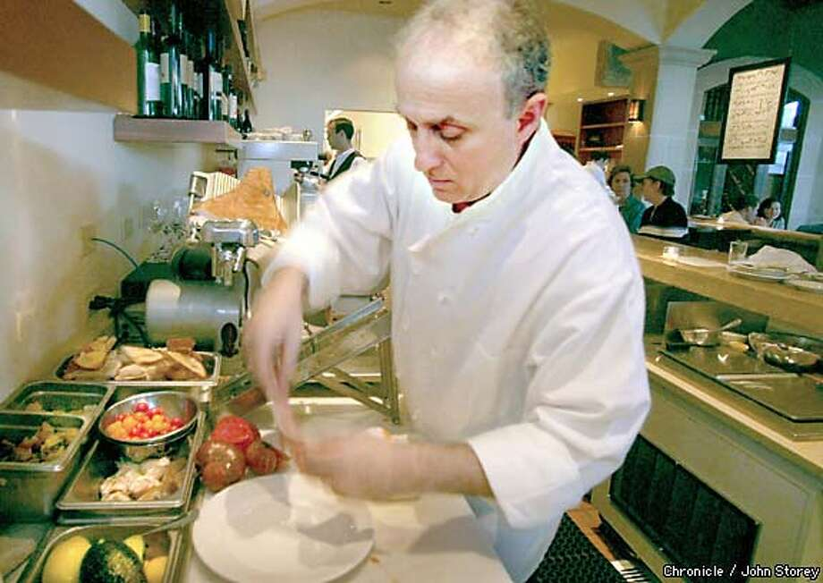 Chef Paul Buscemi prepares salads, which reign supreme as appetizers at Incanto. Chronicle photo by John Storey