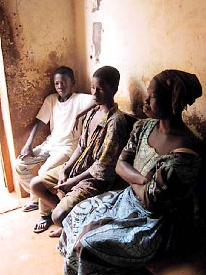 "Blaise Damagoa and other accused ""witches"" wait to be questioned at the police station in Bangui, Central African Republic. Photo by Lucy Jones, special to the Chronicle"