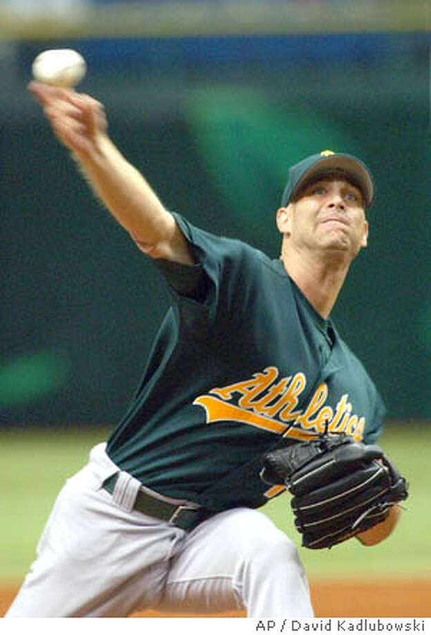 Oakland Athletics starter Tim Hudson throws during the first inning against the Tampa Bay Devil Rays, Sunday May, 2, 2004 in St. Petersburg, Fla. (AP Photo/David Kadlubowski) Photo: DAVID KADLUBOWSKI