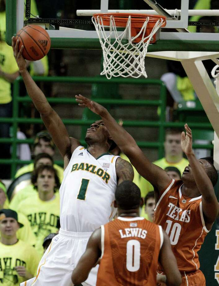 Baylor's Perry Jones III (1) goes up for a backward layup as Texas's Julien Lewis (0) and Jonathan Holmes (10) defend in the first half of an NCAA college basketball game Saturday, Jan. 28, 2012, in Waco. Photo: Tony Gutierrez, Associated Press / AP