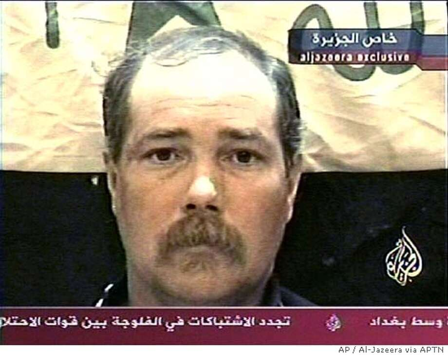 ** FILE ** Thomas Hamill, an American civilian captured April 9, 2004, during an ambush of a convoy west of Baghdad, is shown in this undated image from a videotape given to the Al-Jazeera television network. Hamill was found by U.S. forces Sunday, May 2, 2004, south of Tikrit, Iraq, after he apparently escaped from his captors, the U.S. military said. (AP Photo/Aljazeera via APTN, File)