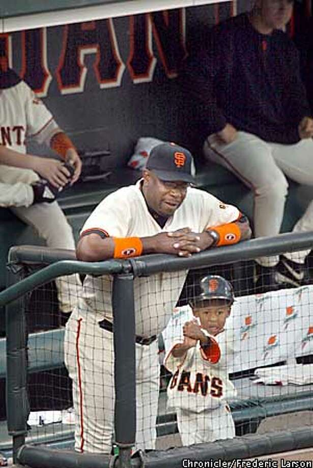Giants manager Dusty Baker and his son Darren watch the early inning of the game together in the Giants dugout. The San Francisco Giants play the St. Louis Cardinals in game four of the National League Championship Series at Pac Bell Park in San Francisco, Ca. October 13, 2002. Giants lead the series 2-1. (Fredric Larson/SAN FRANCISCO CHRONICLE) Photo: Fredric Larson