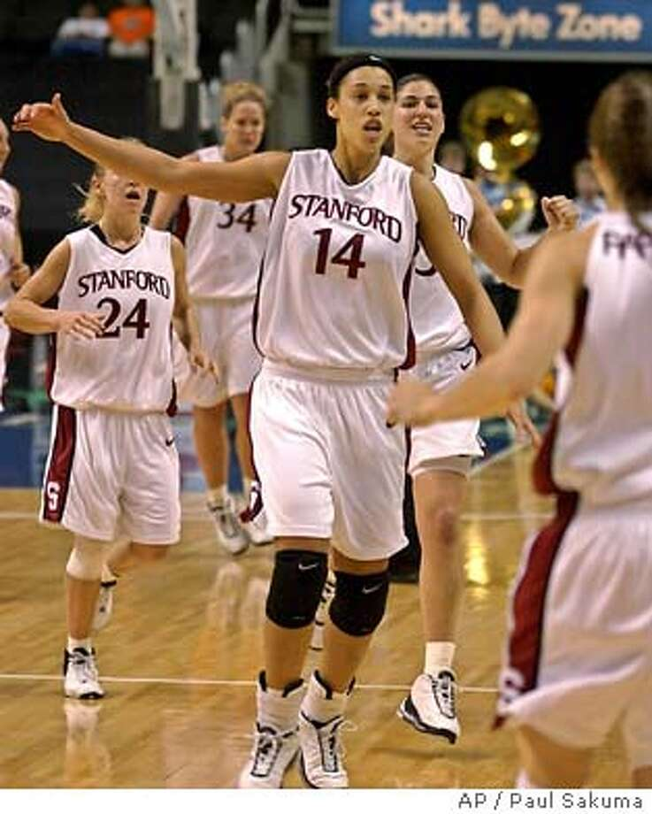 Stanford forward Nicole Powell (14) celebrates as she is followed by guard Susan King (24), forward T'Nae Thiel (34), and guard Sebnem Kimyacioglu, right, just seconds after Stanford defeated UCLA 70-66 in the semifinals during the Pac-10 tournament in San Jose, Calif., Sunday, March 7, 2004. Powell was co-high scorer with 18 points. Stanford plays Arizona in the finals on Monday. (AP Photo/Paul Sakuma) Nicole Powell leads the Stanford players off the court in celebration after a come-from-behind win over UCLA. Photo: PAUL SAKUMA