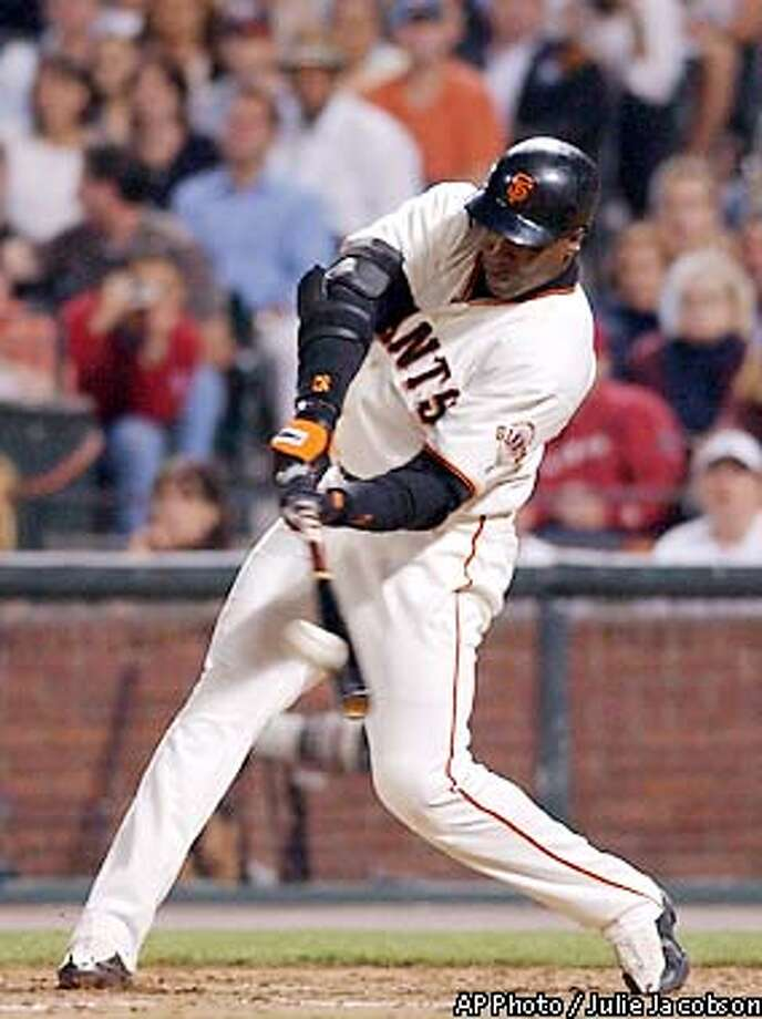 San Francisco Giants' Barry Bonds connects for his 600th career home run, a solo shot against the Pittsburgh Pirates during the sixth inning Friday, Aug. 9 2002 in San Francisco. (AP Photo/Julie Jacobson) Photo: JULIE JACOBSON