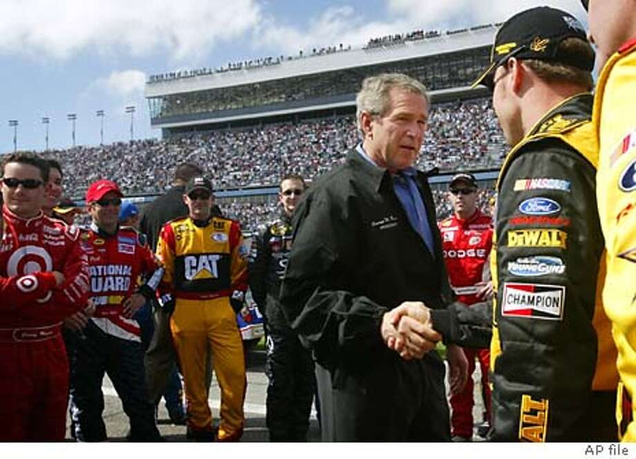 ** FILE ** President Bush, left, greets drivers in the pit at the Daytona 500 NASCAR race in this Feb. 15, 2004, file photo in Daytona Beach, Fla. Bush's appearances before sports audiences offer some potent election-year benefits and help him shore up his already strong standing with his core base of support, white men. (AP Photo/Pablo Martinez Monsivais, File) Photo: PABLO MARTINEZ MONSIVAIS