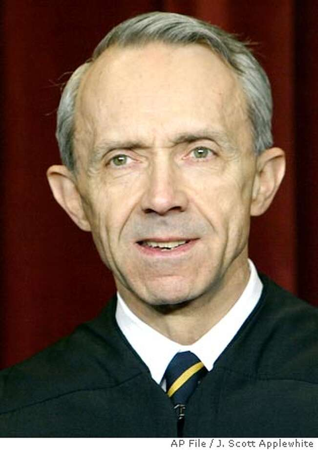 ** FILE ** U.S. Supreme Court Justice David Souter poses during a photo session at the Supreme Court in Washington in this Dec. 5, 2003 file photo. Souter suffered minor injuries when a group of young men assaulted him as he jogged on a city street Friday evening in Washington. Souter was taken to a hospital and later released. (AP Photo/J. Scott Applewhite, File) Photo: J. SCOTT APPLEWHITE