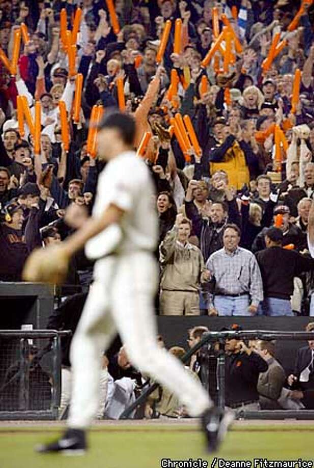 Giants Rob Nenn walks off the field after throwing the final out in the ninth inning of play. The San Francisco Giants play the St. Louis Cardinals in game four of the National League Championship Series at Pac Bell Park in San Francisco, Ca. October 13, 2002. Giants lead the series 2-1. (Deanne Fitzmaurice/SAN FRANCISCO CHRONICLE) Photo: Deanne Fitzmaurice