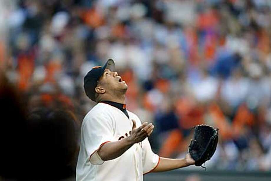 Giants starting pitcher Livan Hernandez looks skyward for a little help as he leaves the field after getting in another tight spot during the third inning of play. The San Francisco Giants play the St. Louis Cardinals in game four of the National League Championship Series at Pac Bell Park in San Francisco, Ca. October 13, 2002. Giants lead the series 2-1. (CARLOS AVILA GONZALEZ/SAN FRANCISCO CHRONICLE) Photo: CARLOS AVILA GONZALEZ