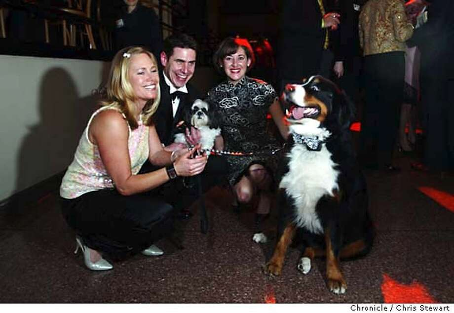 "party07039_cs.jpg Event on 2/26/04 in San Francisco.  AJ Folk (L), Daniel Crain and Michele Stamatopoulos with Harley (the big dog) and Simon at the SPCA's annual ""Bark & Whine Ball.'' Crain is president of the SPCA and Folk and Stamatopoulos are event co-chairs. The ball features patrons' pooches dressed up in Mardi Gras finery. The event took place at the Gift Center Pavilion, 888 Brannan St., San Francisco. Chris Stewart / The Chronicle Photo: Chris Stewart"