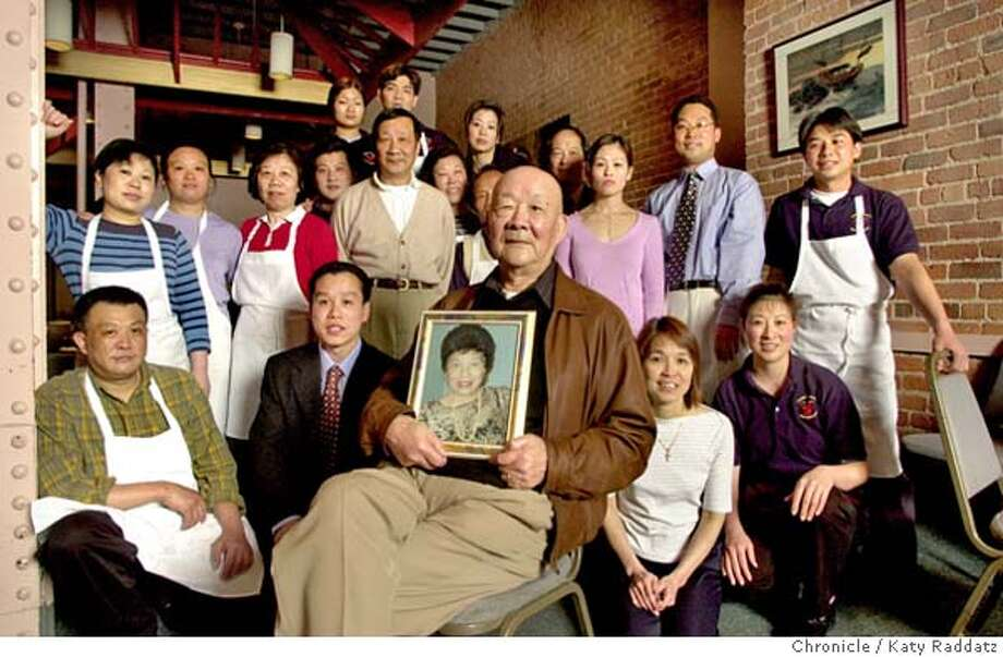 SHOWN: Center sits Henry Chung, the patriarch of the Chung family, who has been running the Hunan restaurant since 1974. Henry holds a portrait of his late wife, Diana Chung, who was instrumental in his life and business. Surrounding Henry are 19 employees of the restaurant, most of them related to Henry. The Chung family has been operating Hunan Restaurant since 1974. An estimated 40 relatives work for the restaurant, making it a true family business. We go to the Hunan at 110 Natoma St. in San Francisco to photograph the Grandfather, Henry Chung, with a gathering of relatives who work in the restaurant. Katy Raddatz / The Chronicle Photo: Katy Raddatz