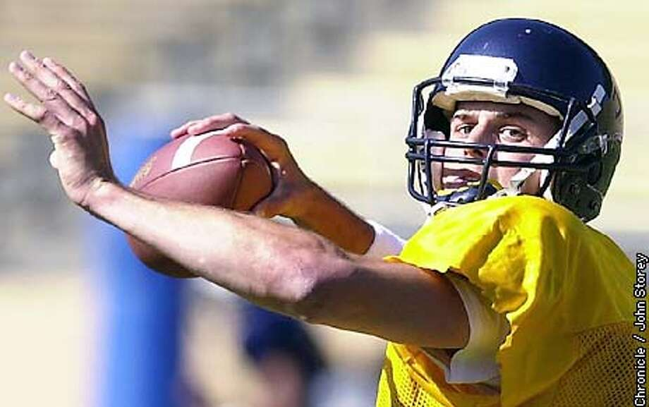 CALFOOT-C-24APR02-SP-JRS-The new Cal Football Coach Jeff Tedford and starting quarterback Kyle Boller during practice at Memorial Stadium in Berkeley. Chronicle Photo by John Storey.