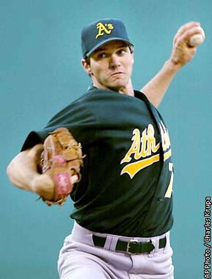 Oakland Athletics starting pitcher Barry Zito delivers a pitch during the first inning against the Boston Red Sox at Fenway Park in Boston, Thursday Aug. 8, 2002. Zito faced Derek Lowe in the match-up, who both have 15 wins this season going into the game. (AP Photo/Charles Krupa) Photo: CHARLES KRUPA