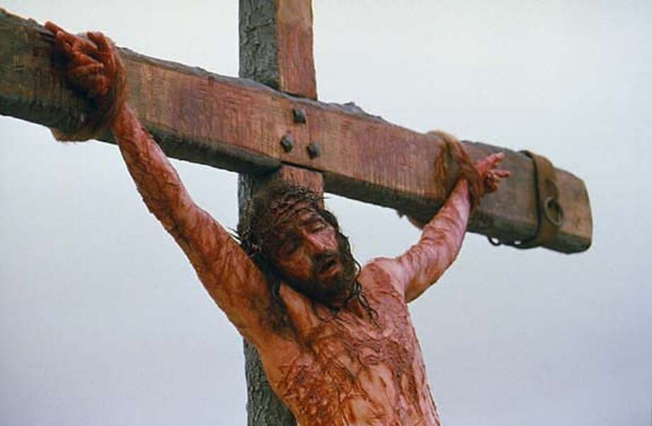 """** ADVANCE FOR THURSDAY, FEB. 19 **FILE**Jim Caviezel, portraying Jesus Christ, is nailed to the cross on the set of """"The Passion of the Christ"""" in this Jan. 24, 2003. publicity photo. Director Mel Gibson insists that the controversial film, set for release Feb. 25, 2004, does not malign Jews. (AP Photo/Philippe Antonello, Marquis Films Ltd.) Jesus, portrayed by Jim Caviezel (second from right), sits with the apostles in a scene from &quo;The Passion of the Christ.&quo; Jesus, portrayed by Jim Caviezel (second from right), sits with the apostles in a scene from &quo;The Passion of the Christ.&quo; Jesus, portrayed by Jim Caviezel (second from right), sits with the apostles in a scene from &quo;The Passion of the Christ.&quo; HFR 02-19-04. ADVANCE FOR THURSDAY, FEB. 19NO SALES. Photo: PHILIPPE ANTONELLO"""