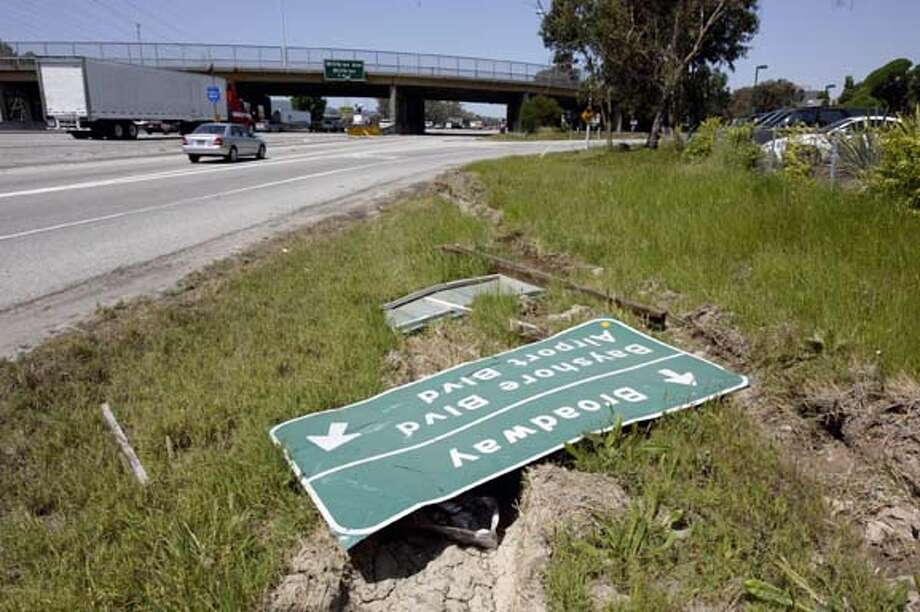Freeway sign on shoulder of Northbound Hwy. 101 is knocked down just before off-ramp at Broadway exit.  Event on 4/27/04 in Burlingame.  Darryl Bush / The Chronicle Photo: Darryl Bush