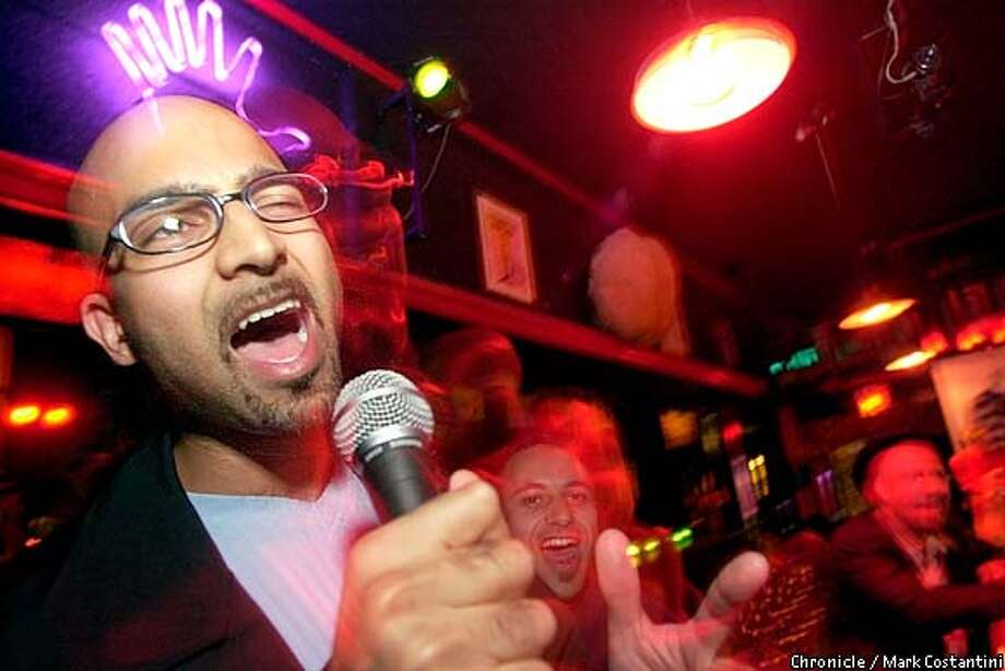 Amateur hour: Anup Navsarikar croons poetry at the Odeon, a San Francisco bar that holds Bad Karaoke Night every Monday. Singing on key can result in disqualification. Chronicle photo by Mark Costantini