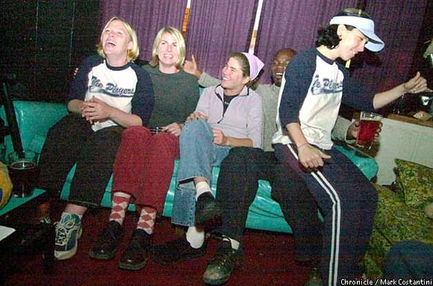 Couch potatoes: The audience enjoys the bad karaoke choices at the Odeon. Chronicle photo by Mark Costantini