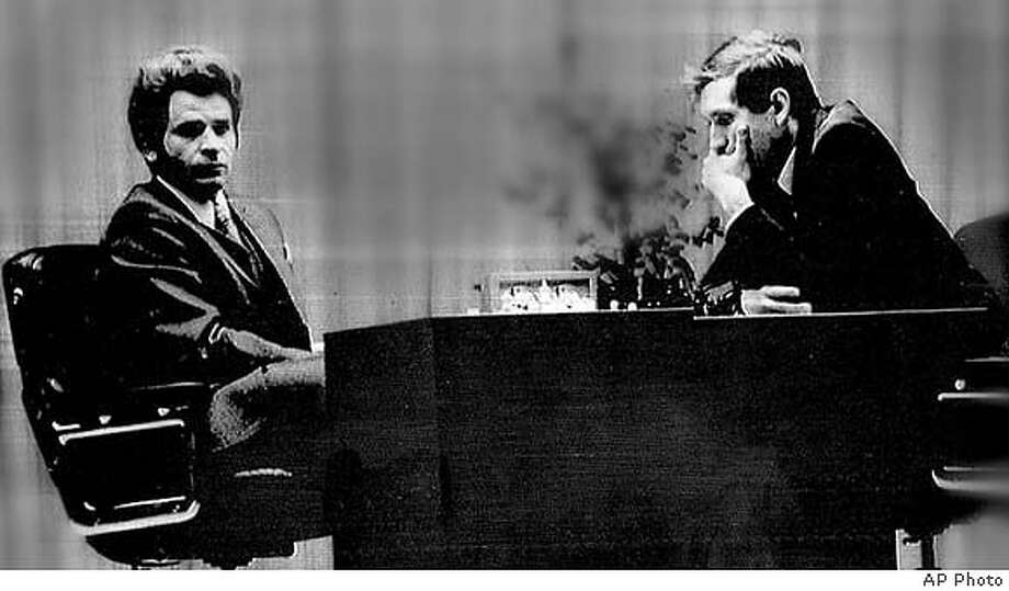Boris Spassky (left) and Bobby Fischer facing off in the 19th game of the World Chess Championships in Laugardol Hall, Reykjavik, Iceland, August 27, 1972. The contest ended in a draw, leaving Fischer the overall tournament leader, 11-8.  Associated Press