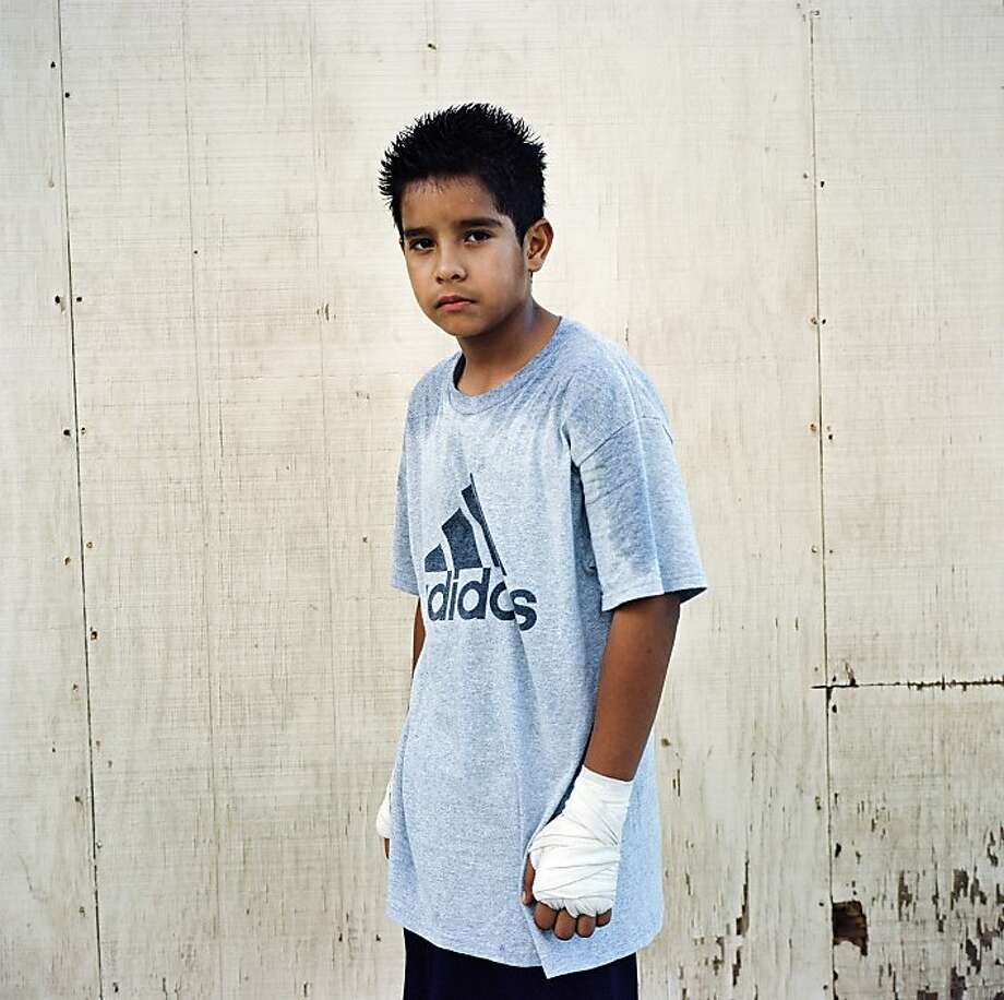 Angel, eleven years old. Thermal, Riverside County.  In his first nine months of boxing, Angel won three belts, including the Junior Golden Gloves Championships for his age and weight.  goes with insight series for 01/29/12 Photo: Lisa M. Hamilton