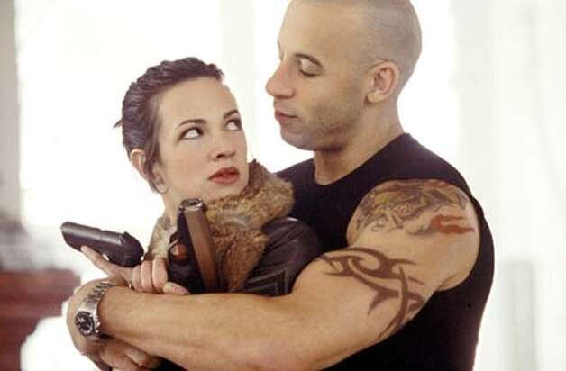 "Yelena (Asia Argento) is beautiful but hardened as Xander's (Vin Diesel) girlfriend in ""XXX."""